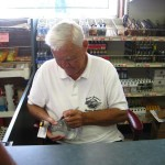 Junior Johnson signing my bottle of Midnight Moon