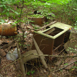 5 Ways to Tell If That Pile of Garbage You Found in the Woods Is a Moonshine Still